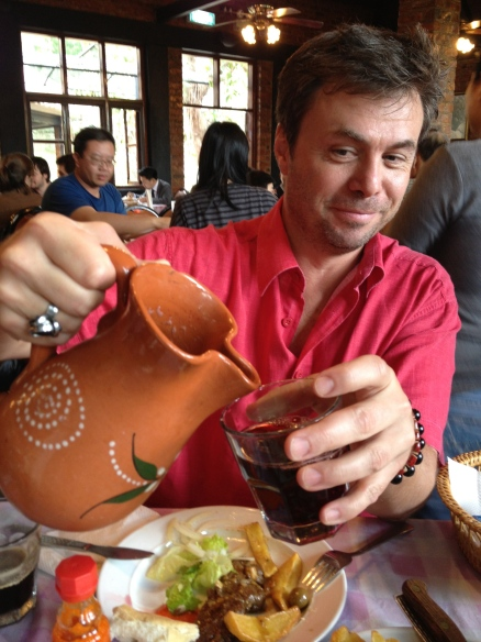 Dean pours the Sangria.