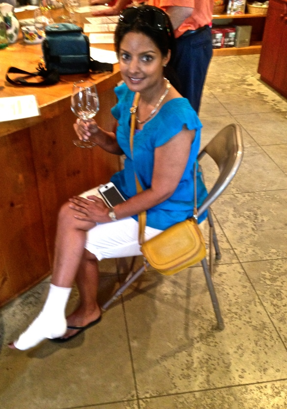 Angela sits at the tasting bar after an unfortunate fall in Austin.